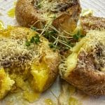 Baked smashed potatoes with garlic sauce and parmesan