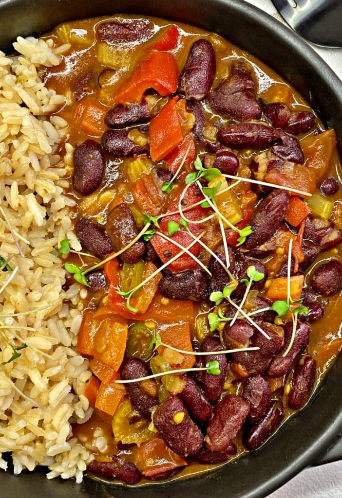Red beans and rice garnished with greens