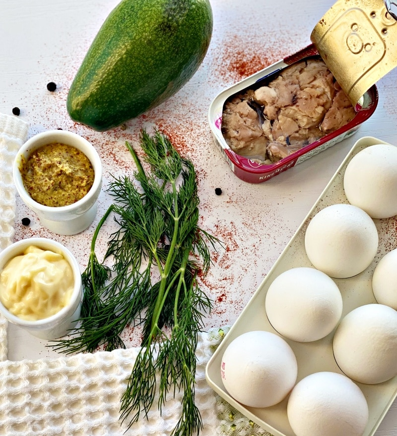 Stuffed deviled eggs with avocado and cod liver ingredients