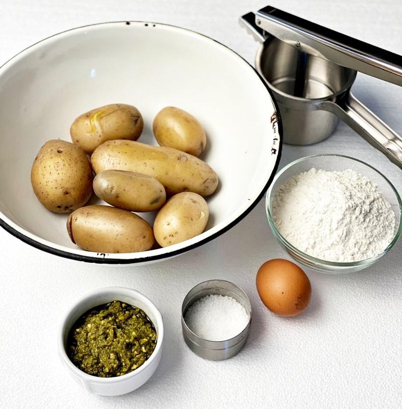 potato ricer, boiled potatoes with eg flour salt and pesto sauce