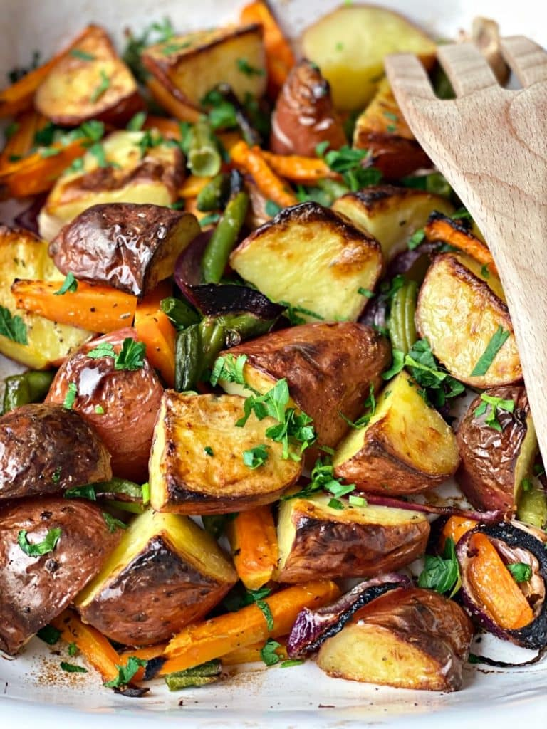 Roasted Garlic Potatoes with green beans and carrots in the oven