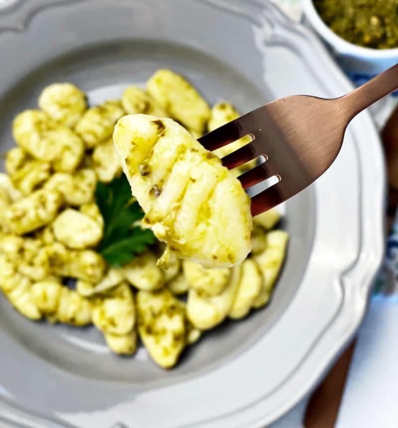 homemake gnocchi with pesto on fork